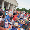 Staff photo by Cathy Spaulding<br /> Timothy Baptist Church volunteers serve hamburgers, hot dogs, chips and sweets to hordes of visitors at<br /> the church's fireworks display and Independence Day celebration Monday.