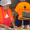 Staff photo by Mike Elswick<br /> Shirley Maxey serves as site manager for the SAC Nutrition program's Rayfield Baptist Church location where several hundred meals a day are prepared and distributed to Muskogee area disabled residents and people aged 60 and older. She is seen in the kitchen helping prepare lunch.