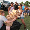 CATHY SPAULDING/Muskogee Phoenix<br /> Kambri Johnson, 12, right, tries to catch her toppling Jenga tower while her sister, Kadee Johnson, 10, watches. Kambri tried building the tower during Timothy Baptist Church's Independence celebration on Tuesday.