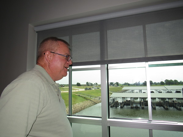 Staff photo by Cathy Spaulding<br /> Dave Davis looks through his office window at the Three Forks Harbor Marina. Davis recently retired after 18 years with the Port of Muskogee.