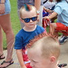 Staff photo by Cathy Spaulding<br /> Rustyn Duncan, left, and Ryder Duncan, both 3, show off patriotic Mohawk-style haircuts while waiting for the parade to start.