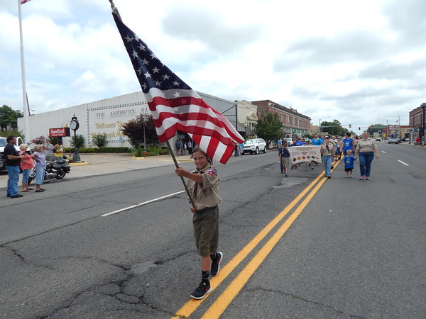Staff photo by Cathy Spaulding<br /> Boy Scouts and Cub Scouts lead the Independence Day parade Monday through downtown Wagoner.