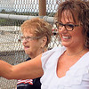 Staff photos by Mike Elswick<br /> Sarah-Marie Hill, 93, and her daughter, Mary Warmuth, were among about 20 people waving flags to motorists below from the pedestrian walkway over Peak Boulevard on Tuesday. They were participating in the third annual July Fourth Raise the Flag event to share their love of America and the flag. Hill said her husband was a World War II veteran who was very patriotic and that she wanted to participate in the Independence Day celebration in his honor.