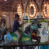 ABIGAIL HALL/Muskogee Phoenix<br /> Kids had fun riding on Mindi's Carousel in Muskogee First Assembly's children's building.
