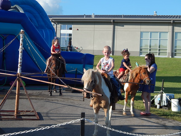 ABIGAIL HALL/Muskogee Phoenix<br /> Local children enjoy pony rides on Independence Day at Muskogee First Assembly's Freedom Celebration. Other activities were a waterslide, a carousel, face painting and a fireworks show.