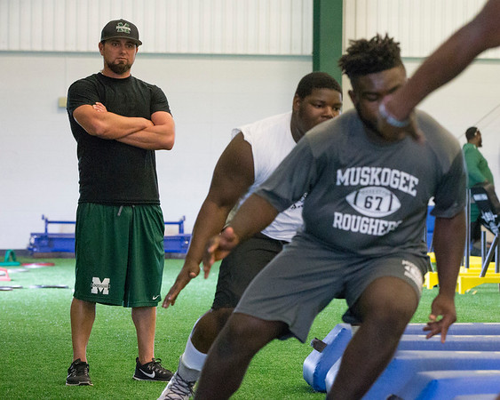 Phoenix special photo by Von Castor<br /> Jason Sexton, Muskogee's new defensive coordinator, observes some of his players do through drills earlier this week. Sexton arrived at Muskogee after 14 years at Midwest City.