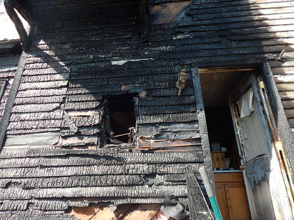 KENTON BROOKS/Muskogee Phoenix<br /> Randy Holland said he believes fireworks may have caused his home to catch fire and destroy two vehicles. However, the cause of the fire is still under investigation.