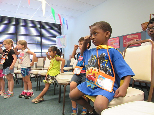 Staff photo by Cathy Spaulding<br /> Ja'Corey Billings, right, and other pupils at St. Paul United Methodist Church Vacation Bible School demonstrate that faith heroes need wisdom. The children were participating in a VBS music class.