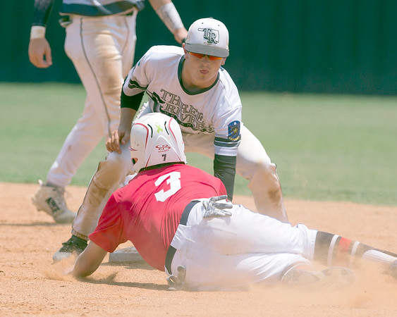 VON CASTOR/Special to the Phoenix<br /> Three Rivers' Boone Lassiter tags out an ABC base runner Friday afternoon in the opening round of the Rusty Fulps Memorial Tournament at Connors State.