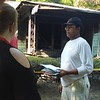 KENTON BROOKS/Muskogee Phoenix<br /> Homeowner Alex Walker Sr., right, talks with a Red Cross representative outside of his home at 913 Elgin St., after an early Friday morning fire did an estimated $75,000 in damage. Walker was living in house with his son, Alex Walker Jr.,<br /> when a smoke detector sounded and woke them up. Walker said he's lived in the<br /> house since 1985.