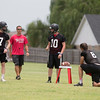 Phoenix special photo by Von Castor<br /> Hilldale quarterback candidates Tyler Goad, Kort Morgan and Jaron Nail listen to Hornets coach Chad Kirkhart in a drill Thursday.