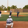 Phoenix special photo by Von Castor<br /> Lase Fulps, left, and his grandfather Jake throw out ceremonial first pitches honoring the late Three Rivers coach Rusty Fulps, Lase dad and Jake's son, prior to Three Rivers' game on Friday against Okmulgee County in the Rusty Fulps Memorial July Showcase in Warner. Jordan Wiggins, front, prepares to catch Jake's pitch. Also participating in the ceremony, but not pictured, were Okmulgee County coach Chico McGirt and Three Rivers coach Mike Whitten.