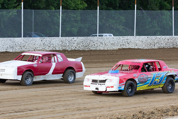 Phoenix special photo by Shane Keeter<br /> Hulbert's Jack Potts, left, tries to get around Tyler Chambers of Welling during Friday's Pure Stock heat at Thunderbird Speedway. Potts out dueled Chambers to win the heat.