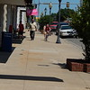 KENTON BROOKS/Muskogee Phoenix<br /> Pedestrians walk or ride a bike down Cherokee Street in Wagoner. The street will be getting new sidewalks for a two-block area from the railroad tracks and going east to Casaver Avenue.