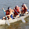 JOHN HASLER/Phoenix Special Photos<br /> Shannon George, Stacy Hogle and Caitlin Hasler paddle to the finish line to win the women's short course title at the Port to Fort Adventure Race on Saturday.