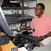 Cathy Spaulding/Muskogee Phoenix<br /> A self-confessed technology geek, the Rev. Charles Moore works in the sound and video booth at First Baptist Church, Summit. He is able to livestream worship services.