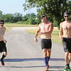 JOHN HASLER/Phoenix Special Photos<br /> David Ott, Levi Fewell and Cody Moore cross the finish line first in the short course team competition at the Port to Fort Adventure Race on Saturday.