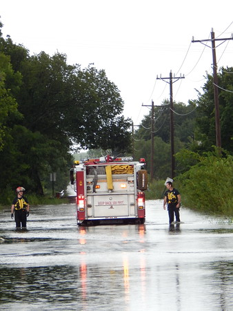 Staff photo by D.E. Smoot<br /> Muskogee firefighters prepare to rescue a motorist who became stranded Wednesday after attempting to traverse a flooded intersection at South York Street and Smith Ferry Road.