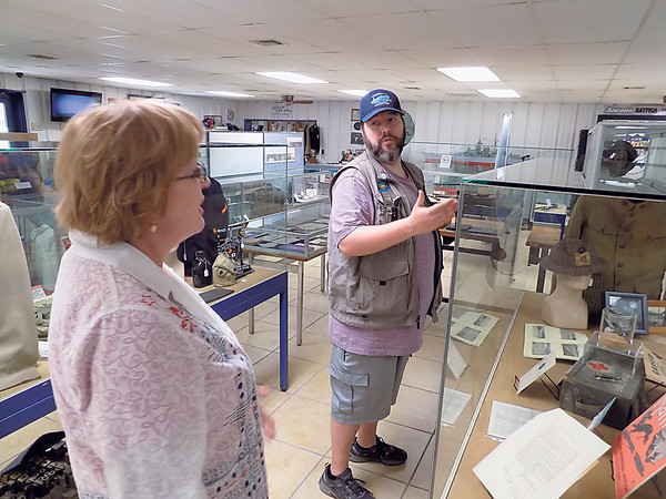 Staff photo by Mike Elswick<br /> Dr. Diane Johnston visits with Brent Trout, director of the Muskogee War Memorial Park, about items she and her family recently donated to the museum that her grandfather brought home to Eastern Oklahoma after his service in World War I. The items that had been stored in a closet for decades included medals, uniforms, military papers and posters from the era, Johnston said.