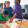 Staff photo by Cathy Spaulding<br /> Teacher Teresa White helps Jason Woodfaulk, 8, with a lesson while Anayiah Gomez, 9, watches. The students are learning at the Dream Team summer program, which runs through July 27 at the Dr. Martin Luther King Jr. Community Center.