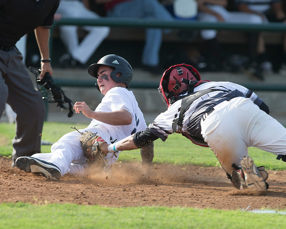 Phoenix special photo by Von Castor<br /> Three Rivers' Jordan Wiggins tags out American Baseball Club's Baylor Simmons at home plate in the first inning of the first game Wednesday at Muskogee.