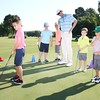 Special photo by John Hasler<br /> Muskogee Golf and Country Club pro Mark Budler works with Judah Holloway, Perry Bartley, Zade Fast, Hudson Madewell and Paxton Fillman on Thursday morning in the club's annual youth clinic. About 25 kids ages 7-17 are participating in the weeklong event.