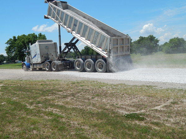 Staff photo b y Mark Hughes<br /> Gravel is laid atop the main dirt road at the Checotah Sports Complex Thursday in preparation for Saturday's Old Settlers Day. A baseball tournament for 6- to 8-year-olds will begin right after the 10 a.m. parade.