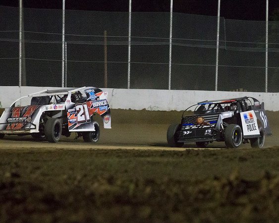 Phoenix special photo by Von Castor<br /> Muskogee's Ron Yates, right, and Elk City's Austin Bonner look for the green flag as they come out of turn four in heat two of the A Modified's Friday night at Thunderbird Speedway. Bonner went on to win the heat.