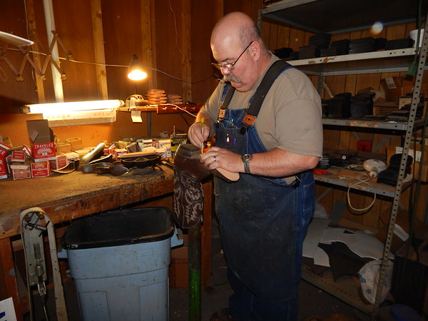 KENTON BROOKS/Muskogee Phoenix<br /> Russell Pofahl starts to put new soles on a pair of boots in his shop in Wagoner. Pofahl has the only shoe repair business in this area.