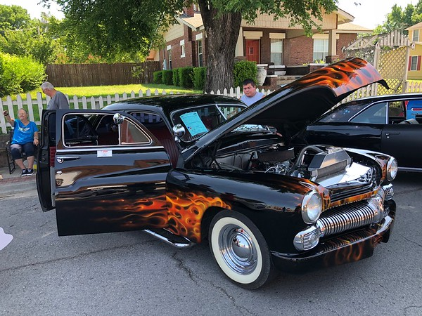 "Charles Miller brought a 1950 four-door Mercury sedan to Saturday's auto show, sporting a ""soft spray"" flame decal."