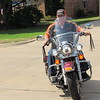 CATHY SPAULDING/ Muskogee Phoenix<br /> Ron Hood rides his motorcycle around his neighborhood. He likes taking weekend rides with his son.