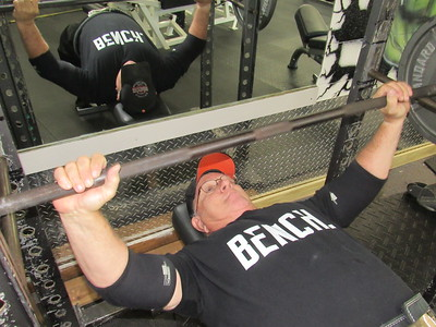 CATHY SPAULDING/ Muskogee Phoenix Ron Hood practices bench pressing at Strictly Fitness. He said he has bench pressed as much as 560 pounds in his later years.