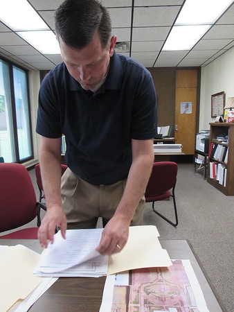 Fort Gibson Superintendent Scott Farmer checks data about a new circular driveway. Construction could begin at the end of this week.