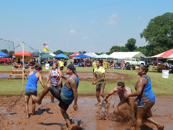 Staff photo by Mark Hughes<br /> One of the 44 teams in Saturday's Mudstock volleyball competition struggles to get to the ball. The two biggest complaints about playing volleyball in the mud pits were that it was too slippery or sticky.