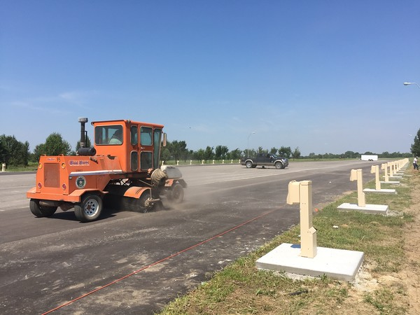 Staff photo by D.E. Smoot<br /> Workers prepare pads and pedestals for recreational vehicles expected to be brought in this week for G Fest, which begins Thursday and continues through Saturday.