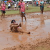 Staff photo by Mark Hughes<br /> Kendra Olmstead, playing for Kinky Sets, takes one for the team during a Mudstock volleyball game Saturday at Three Forks Harbor. This is her fifth year playing in the mud pits.