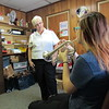CATHY SPAULDING/ Muskogee Phoenix<br /> Muskogee Salvation Army Major Sue Dewan listens as teen Lexi Sessions plays the trumpet before heading to Salvation Army camp on Monday. Dewan and her husband, Dave Dewan, are retiring at the end of this week.