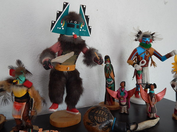 Staff photo by Mark Hughes<br /> Large and medium-sized Kachina dolls line a shelf at Dr. Patti Jo King's office at Ba- cone College. The dolls are made by Pueblo Indians and are carved from one piece of wood with the maker's name signed on the bottom, King said. The smaller Kachina dolls were made by Hopi Indians. King is the interim division chair and assistant professor of American Indian Studies at Bacone College.