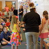 Staff photo by Mike Elswick<br /> Erica Buckwalter, naturalist with the Oklahoma City Zoo, presented a program on architects of the animal kingdom to youngsters at the Q.B. Boydstun Public Library in Fort Gibson. She used members of the audience to demonstrate various building techniques used by animals and insects to serve as nests for newborns and protection.
