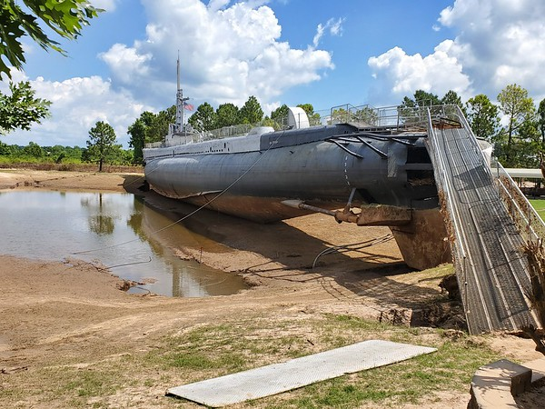 CHESLEY OXENDINE/Muskogee Phoenix<br /> Receding flood waters placed the USS Batfish beside its original spot in the War Memorial Park. Now that the boat is stable, repairs have begun.