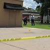 CATHY SPAULDING/Muskogee Phoenix<br /> Muskogee police check where shell casings landed after a Wednesday afternoon shooting.