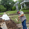 Staff photo by Cathy Spaulding<br /> City of Muskogee street worker David Christopher Davis digs Monday into an area where a sidewalk is being replaced on 13th Street at Boston Street. Davis said the previous segment of sidewalk had to be taken out so the city could fix a water leak.