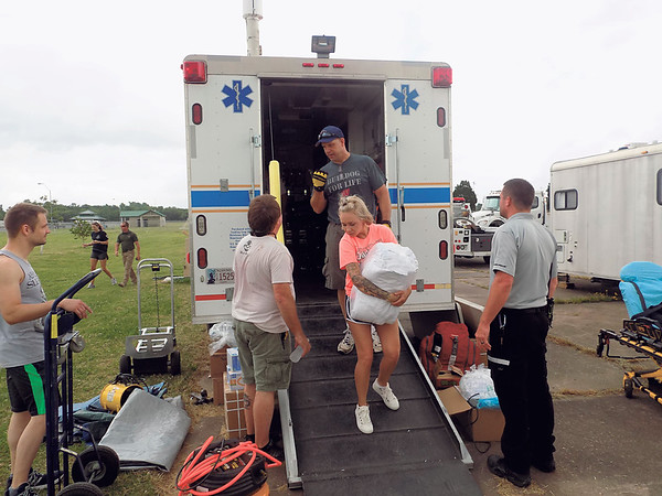 Staff photo by Mike Elswick<br /> City, county and state emergency workers were busy Tuesday setting up temporary medical facilities and a mobile command center that will be used during the three-day run of G Fest Muskogee beginning Thursday.