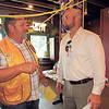 KENTON BROOKS/Muskogee Phoenix<br /> Rick Riggs, left, president of the Muskogee Noon Lions Club, talks with Dennis Read, business manger at Oklahoma School for the Blind, at the club's annual Benevolent Donor Banquet on Wednesday. The school received a check for $500 from the Lions Club.