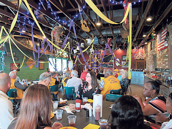 KENTON BROOKS/Muskogee Phoenix<br /> People gathered Wednesday for the annual Muskogee Noon Lions Club Benevolent Donor Banquet at Cowboy's Bar-B-Q & Grill. Area organizations received checks the club raised from their pancake breakfast held in March at the Muskogee Civic Center.
