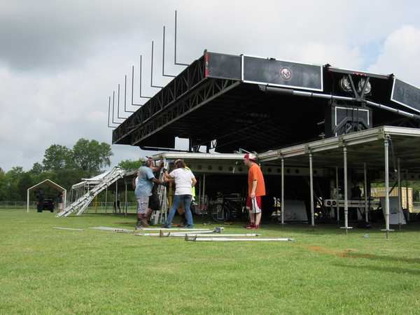 Staff photo by Cathy Spaulding<br /> Stage techs with Premier Global Productions set up wings Tuesday beside the Love-Hatbox main stage at Love-Hatbox Sports Complex. The stage will be the site of several major acts during G Fest.