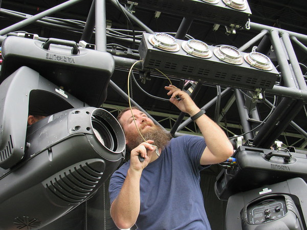 Staff photo by Cathy Spaulding<br /> Stage crew member Chad Smith adjusts mole lights for the G Fest Main Stage. The Main Stage will feature headliners such as the Nitty Gritty Dirt Band, Kentucky Headhunters and Creedence Clearwater Revisited.