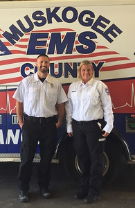 ABIGAIL HALL/Muskogee Phoenix Brandt Hiler, left, and Kristen Bias received the national Star of Life award from the American Ambulance Association on Tuesday evening.