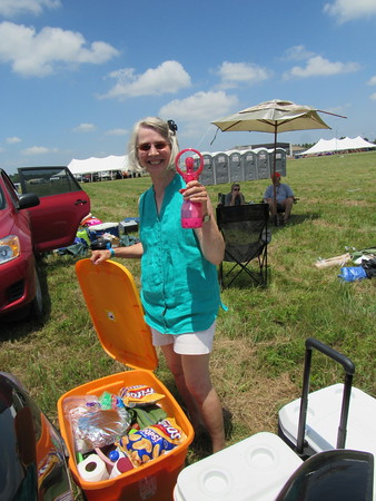 Staff photo by Cathy Spaulding<br /> Barbara Carlozzi of Stillwater shows a misting fan she brought to G Fest. High temperatures are expected during the festival.