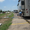 Staff photo by Cathy Spaulding<br /> Tony Spatz of Fort Gibson hooks a hose to his RV on Wednesday at Love-Hatbox Sports Complex. Crews installed 153 hook-ups for electricity and water.
